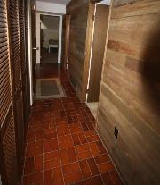 tiled floors and cedar walls leads to each bedroom